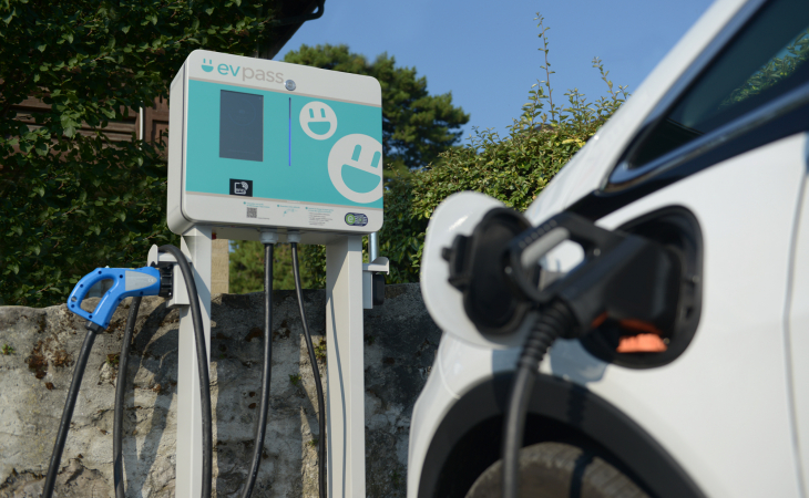 evpass charging station with an electric car