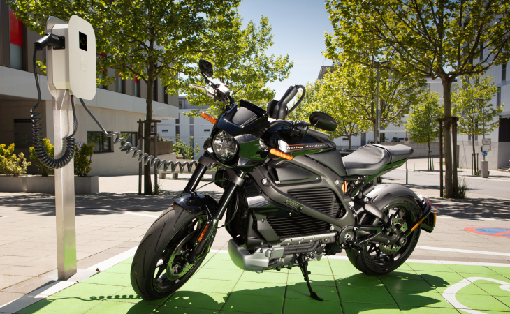 Electric motorcycle charging on a Green Motion Private One