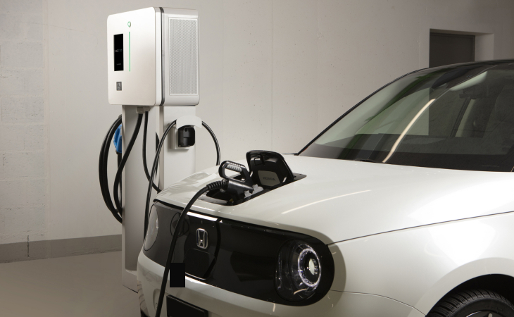 Electric car charging on a fast charging station by Green Motion